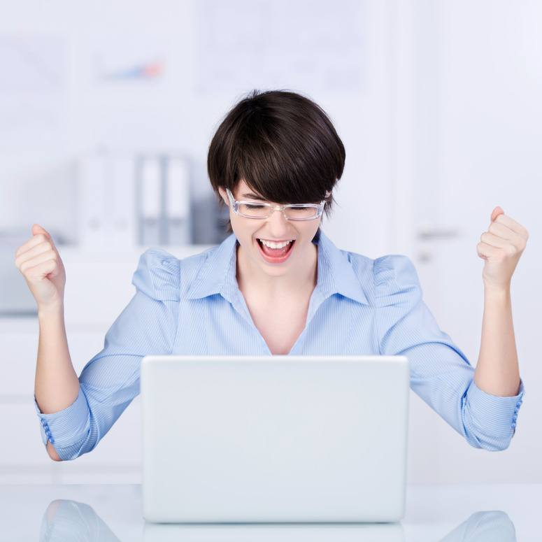 Excited businesswoman rejoicing